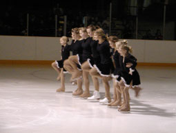 Team of young girl skaters on the ice